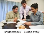 businesspeople reviewing... | Shutterstock . vector #138555959
