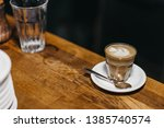 a small cup of specialty... | Shutterstock . vector #1385740574