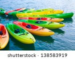 Group Of Colorful Kayaks On...