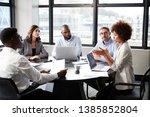 black businesswoman addressing... | Shutterstock . vector #1385852804