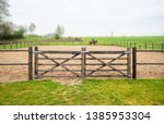 wooden gate to an equine... | Shutterstock . vector #1385953304