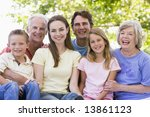 extended family outdoors smiling | Shutterstock . vector #13861123
