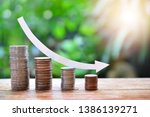 Small photo of pile money coins saving trend decrease for investment mutual fund finance and business