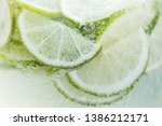 close up fresh lemon slices in... | Shutterstock . vector #1386212171