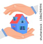 hands protecting cottage  flat... | Shutterstock .eps vector #1386298994