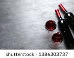 glasses and bottles with red... | Shutterstock . vector #1386303737