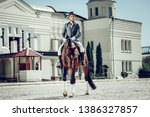 My passion. Handsome young man having fun while enjoying his horse ride - stock photo