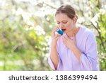 woman with inhaler having... | Shutterstock . vector #1386399494