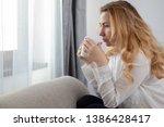 caucasian blonde woman sitting... | Shutterstock . vector #1386428417