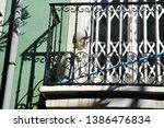 female mannequin on the balcony ... | Shutterstock . vector #1386476834