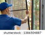 Worker Installing Mosquito Net...