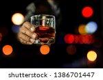 soft focus of hand holding... | Shutterstock . vector #1386701447