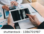 managers are using tablets to... | Shutterstock . vector #1386701987