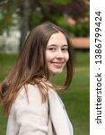 beautiful young woman posing... | Shutterstock . vector #1386799424