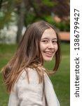 beautiful young woman posing... | Shutterstock . vector #1386799427