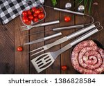 barbecue tools and sausage on... | Shutterstock . vector #1386828584