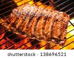 grilled pork ribs on the grill. | Shutterstock . vector #138696521