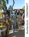 Small photo of Barberville, Florida, USA - 3/20/19: yard art emporium. with lots of interesting and kitschy yard art including a dinosaur and a suit of knights armor