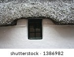 Snow Covered Thatch Cottage