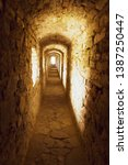 old stony passage in ancient... | Shutterstock . vector #1387250447