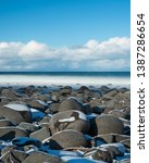 long exposure on unstad beach... | Shutterstock . vector #1387286654