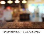 empty dark wooden table in... | Shutterstock . vector #1387352987