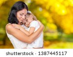 happy mother and child girl | Shutterstock . vector #1387445117