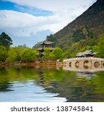 Chinese Pagoda Reflecting In...