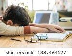 an asian preteen boy lying... | Shutterstock . vector #1387464527