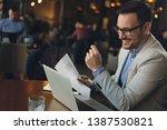 happy businessman working on... | Shutterstock . vector #1387530821