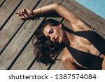 sensual young woman in bikini...   Shutterstock . vector #1387574084