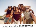 group of happy friends having... | Shutterstock . vector #1387577537