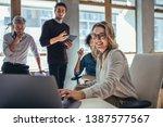 female entrepreneur working on... | Shutterstock . vector #1387577567