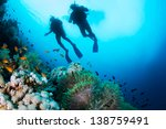two silhouettes of scuba divers ... | Shutterstock . vector #138759491