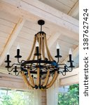 wrought iron chandelier with... | Shutterstock . vector #1387627424