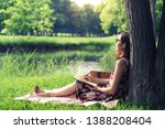 young asian woman writing on... | Shutterstock . vector #1388208404