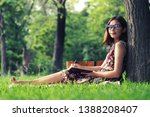 young asian woman writing on... | Shutterstock . vector #1388208407
