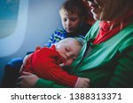 mother with sleeping baby and... | Shutterstock . vector #1388313371