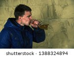 a disheveled man with alcohol...   Shutterstock . vector #1388324894