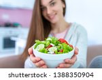 healthy vegan woman holding a... | Shutterstock . vector #1388350904