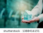 Small photo of Closeup at home That women are dreaming of having house at very affordable price Home buying Renovation home to find loan with good interest. In order to be able to repay the debt without a problem