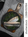 Stock photo marinated herring fillet with green onions on a plate dark background 1388450984