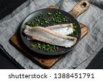 Stock photo marinated herring fillet with green onion on a dark plate 1388451791