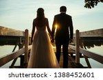 newlyweds walking on a bridge...   Shutterstock . vector #1388452601