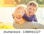 beautiful smile mother and her... | Shutterstock . vector #1388461127
