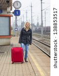 a young woman with suitcase... | Shutterstock . vector #138853517
