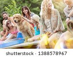 family and friends sitting with ... | Shutterstock . vector #1388578967