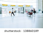 people on the move at the airport - stock photo