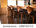 fine wood chairs lined up at a... | Shutterstock . vector #1388705714