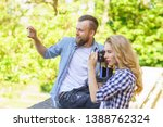man and woman taking photos... | Shutterstock . vector #1388762324